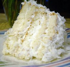 Easy Coconut Refrigerator Cake - don't be fooled by the photo -- this is the most POPULAR recipe on my ENTIRE site!! The cake gets so super moist after sitting in the fridge for a few days. It's the PERFECT coconut cake!! You'll want to try this dessert. The only problem will be fighting the urge to eat it for breakfast!