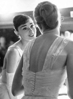 Audrey Hepburn with Grace Kelly backstage at the Academy Awards photographed by Allan Grant, March 21,1956.