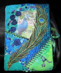 CQing from Connie at Stitching Like Crazy  --  check out that peacock feather!