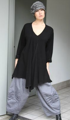 V-neck with pleats on one side only and interesting hem shape.