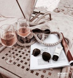 CUTE holiday inspiration, glasses of rose wine on the beach with sunglasses and a magazine