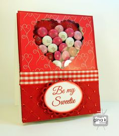 """""""Be My Sweetie"""" candy card!  Made with:  - Gina K Designs """"Lovely Ladybug"""" stamp set by Beth Siliaka  - Gina K Designs Pure Luxury 120 lb Base Weight White card stock  - Gina K Designs Pure Luxury Cherry Red card stock  - Gina K Designs Pure Luxury Smitten 6 X 6 patterned paper pack  - Gina K Designs Color Companions ink pad in Cherry Red  - Gina K Designs Color Companions Ribbon in Red Hot Gingham  - Cuttlebug folder embossing  - Red Gem stones"""