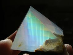 170 carat opal with Contra luz color plays. Origin: Opal Butte, Oregon. Contra Luz opals describe precious opals where the play of colors is only visible when held up to the light.