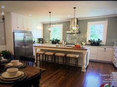 """Kitchen island, range hood, subway tile, pendant lights. Credit: Fixer Upper """"Finding Small Town Texas Charm For A Young Family"""" HGTV Chip and Joanna Gaines"""