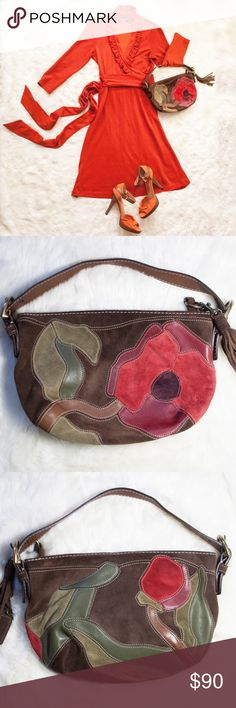"Coach Poppy for Peace Special Edition Hobo Handbag Let yourself bloom with this pretty Coach POPPY for PEACE Special Edition Spring 2004 Hobo Handbag!  Made of multicolor suede & leather patchwork with beautiful floral detail.  This is a rare item and in great, pre-loved condition.  Magnetic clasp, silk lining and a zipper pocket inside.  Interior lining is very clean.   10.6"" Length x 7.5"" Width, Strap drop 4"".  Best offers welcome.  Thanks for looking! Coach Bags Hobos"