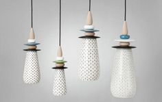 Swedish design studio Glimpt designed these cool hand painted ceramic shades inspired by strawberry pips.