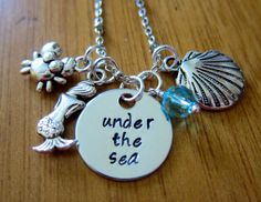 "Little Mermaid Necklace. Under The Sea Necklace. Ariel Necklace. Swarovski crystal, crab charm, mermaid charm and a seashell charm by WithLoveFromOC, $21.00 Disney song. Disney Quote. ""Darling it's better, Down where it's wetter, Take it from me"""