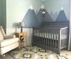 Nursery decor! Modern nursery with mountains and tribal print. Yellow and grey nursery.