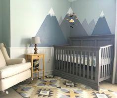 Nursery decor! Modern nursery with mountains and tribal print. Yellow and grey…