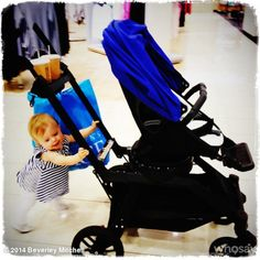 7th Heaven star Beverly Mitchell takes her baby out in an Orbit Baby stroller with a Blueberry sunshade.