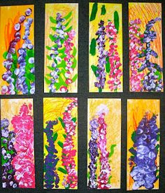 """1st grade lupine flowers for spring. Show images of lupines and excerpts of Miss Rumphius book. First use chalk pastels on the paper. Then scribble on oil pastels onto the background. Add a green paint stem. Dip thumbs into paint to make lupine flowers. When dry, use a black permanent marker to circle around each """"flower"""" which makes gives depth to the final product. Miss Rumphius spread lupine seeds across the countryside to make the world more beautiful."""