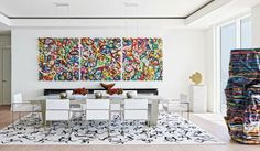 Contemporary dining room | Rectangular Dining table for 8 and a gold-leaf sculpture by Jose Angel Vincench | #diningroomideas #diningroomdecor #diningchairs
