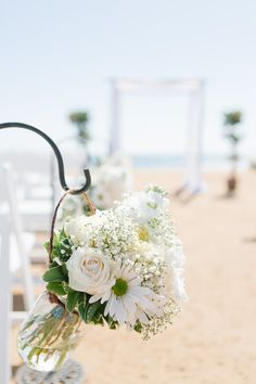 White summer outdoor wedding ceremony aisle marker idea - white flowers in clear…