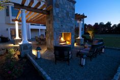 Pea gravel seating area with double sided outdoor fireplace - traditional - patio - baltimore - Clearwater Landscape & Nursery