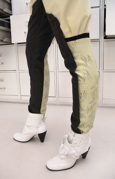 Detail: trousers (wool, silk-screen print), shoes (fake leather)