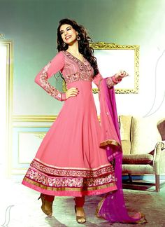 This long anarkali suit with a baby pink color looks very nice the neck and on the sleeves makes the entire looks of the suit remarkable.