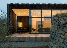 Rural Icelandic cottages by PK Arkitektar have turf roofs and burnt timber cladding Architecture Art Design, Residential Architecture, Timber Cladding, Wooden House, Vacation, Cottages, House Styles, Dezeen, Green Building
