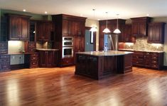 Kitchens With Dark Wood Floors | Large open concept Cherry kitchen - traditional - kitchen cabinets ...