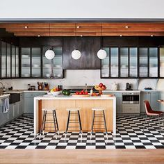 Classic checkerboard tile catches the eye in the kitchen of @naomiwatts's Manhattan home, renovated by @ashe_leandro. Photo by @thefacinator