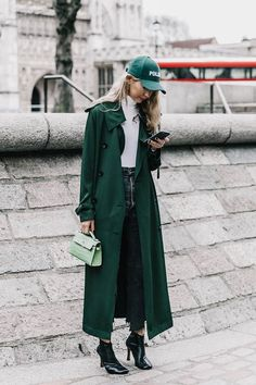 Green street style featuring a long coast, black booties and a baseball cap. Shop for booties like this on ZOOSHOO.con! Cjheck out our QUPID, POINTED TOE ANKLE BOOTIE! ~ Street style London Fashion Week, febrero 2017 © Diego Anciano