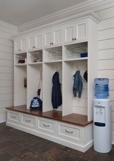 Fantastic mudroom boasts tongue and groove paneled walls used as a backdrop to open and closed mudroom lockers, one for each family member, atop a built-in mudroom bench with drawers for extra storage. bench with drawers Mudroom Cubbies, Mudroom Laundry Room, Bench Mudroom, Mudroom Organizer, Mud Room Lockers, Built In Lockers, Entry Lockers, Home Lockers, Kids Cubbies