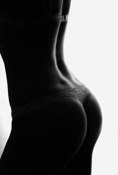 artistic b&w boudoir lingerie silhouette portrait, window, shot with daylight.  Boudoir photography ideas Privé Portraits, NYC boudoir photographer