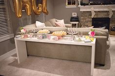 neutral sofa and skinny white table behind for decor or parties