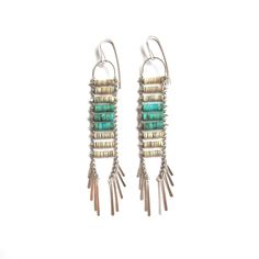 """Turquoise and white Heishi shell beads on silver plated brass chainwith silver tassel fringe and sterling Silver ear wireslength: 4"""" width: .5"""""""