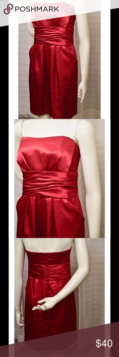 """David's Bridal red gown / dress This listing is for a sz 12 David's Bridal red, short strapless gown. perfect for a bridesmaid dress or a prom dress.  has pockets giving a youthful & still sexy look while worn. length is knee / tea length & the reinforced panels of fabric around the empire waist make this dress flattering for every figure.  The condition is amazing.   The size is 12; this dress measures appx 36"""" around the bust, 32"""" around the waist and appx 31"""" from the top of the neckline…"""