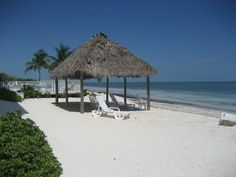 Runaway to this beach front condo on sandy Coco Plum Beach.  Call today to reserve this tropical vacation rental.