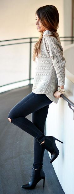 grey sweater + destroyed skinny jeans                                                                             Source