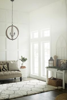 Custom Built Modern Farmhouse Home Tour with Household No 6 | White wood board and batten wall treatment - Wood floor & orb chandelier - French windows - Church arched frame window