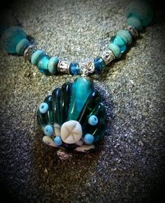 Check out this item in my Etsy shop https://www.etsy.com/listing/238245568/lampwork-shell-beach-necklace