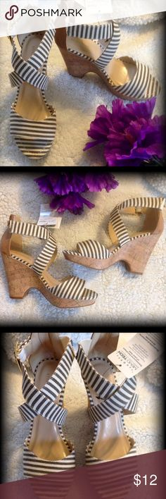 """Very cute Wedges Off white and brown stripes. Approx 4"""" heel. Zip up backs. Gold buckle on side is adjustable. These are new with tag but one has a small area of damage on back that I just noticed, so I will price accordingly. They are still adorable and it may be able to be covered with tan marker. See last photo. Attention Shoes Wedges"""