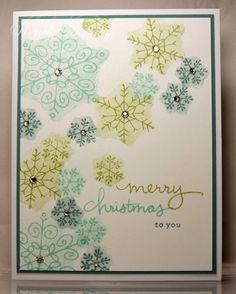I started with the back side of the snowflakes and off-stamped them so the ink would be lighter and then flipped the images to the correct side and stamped the snowflakes.  The card was spritzed with some frost white shimmer mist and then I added the rhinestones for a little more sparkle.
