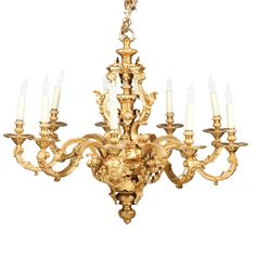 Lot 293 Louis XIV Style Gilt-Bronze Ten-Light Chandelier In the manner of Andre-Charles Boulle, 19th century With foliate decorated curve...