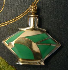 This Art Deco perfume is absolutely outstanding. Very unique and quintessentially Art Deco with the abstract design. Geometric form to the body is