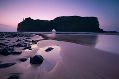 seascape photo of dawn over hole in the wall, wild coast, south africa