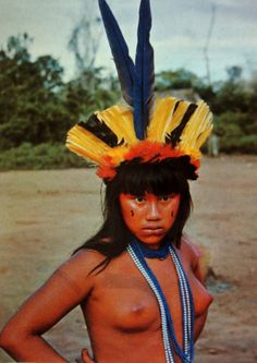 Photo: Young Suiá indian girl dressed up for the Yamaricumã ceremony - Suiá-Missú River, Xingú National Park, Brazil, photographed by Jesco/PNX.