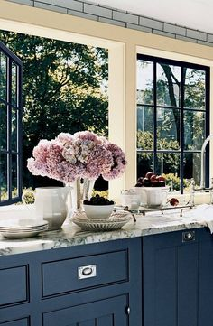 blue cabinets in a sophisticated kitchen.