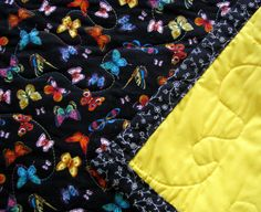 Throw Quilt With Bright Butterflies on a Black Background
