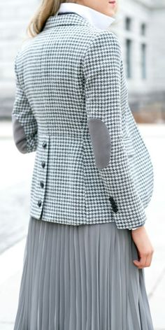 grey houndstooth blazer with elbow patches and leather buttons down back, shawl collar sweater, popped collar button down + pleated midi skirt