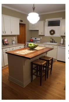 If you or someone you know is planning a kitchen revamp anytime ever see how this reader used stock cabinets trimmed painted and topped with a wood counter to create a custom diy kitchen island jarrah for the farm kitchen solutioingenieria Images