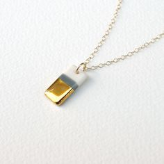 tiny porcelain rectangle necklace in white and gray, gold dipped