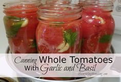 Canning whole tomatoes with garlic and basil elevates the thought behind canned tomatoes. afarmgirlinthemaking.com