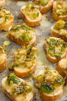 "Shredded Brussels sprouts sautéed in a mixture of garlic and crushed red pepper, then topped on toasts with white cheddar will leave you saying ""Insane!"" in the best way. Get the recipe from Delish.   - Delish.com"