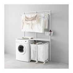 No baskets under just washer and dryer with wire drying rack above. ALGOT Wall upright/shelves/drying rack - IKEA