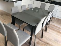 Link glass top extendable dining table with Chic in grey fabric dining chairs. Delivered to our client in London.