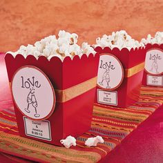 Stamped Popcorn Boxes.  If fresh popcorn is one of your favorite scents, then love will be in the air with these fun favors!