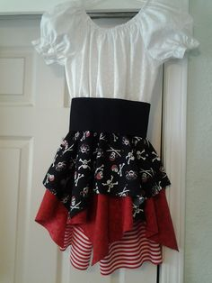 Girl's Pirate costume. This was for the Disney Cruise, even had the du rag out of the black pirate fabric. in this pic the striped bloomers hadn't even been hemmed and the elastic in the legs yet. The belt had eyelets and laced up the front with red ribbon. This is the most re-pined pin that I have, enjoy!